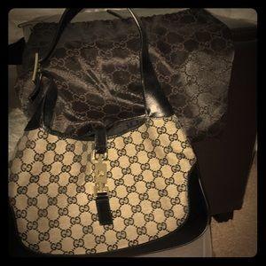 Monogram mixed media luxury bag